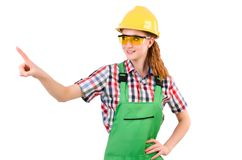 Female handyman in overalls isolated on the white Royalty Free Stock Photography