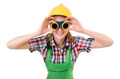 Female handyman in overalls isolated on the white Stock Photos