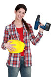 Female handywoman with drill Royalty Free Stock Photo