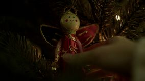 Female hanging Christmas decoration on tree.  stock video footage