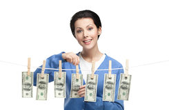Female hangs money on the line Stock Photography