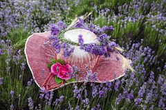 Female hat decorated with lavender flowers Royalty Free Stock Image