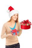 Female with hat holding gifts in her hands Royalty Free Stock Images