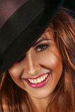 Female on hat and toothy smile Stock Images