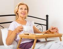 Female having breakfast in bed Stock Image