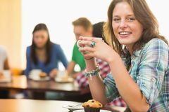Female having coffee and muffin at  coffee shop Stock Image