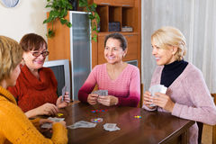 Female having fun with cards Royalty Free Stock Image