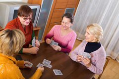 Female having fun with cards Royalty Free Stock Photography