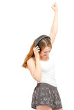Female having fun listening to headphones Royalty Free Stock Photography