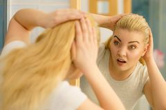 Female having problem with blonde hair stock photo