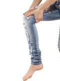 Female having sprain problems, holding her painful leg. Stock Photos