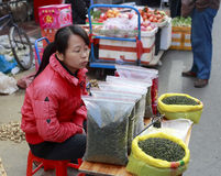 Female hawker selling tieguanyin tea Royalty Free Stock Photo
