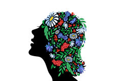 Female head with abstract flowers Stock Photo