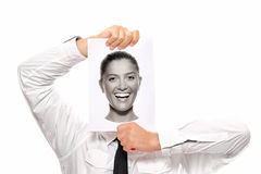 Female head in the hands of a businessman Stock Image