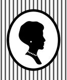 Female head portrait in a frame on the wall with jewelry profile silhouette, vector. Illustration Stock Photography