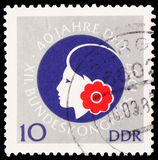 Female head, 40 Years Of Democratic Women\'s Federation Of Germany (DFD) serie, circa 1987. MOSCOW, RUSSIA - JUNE 19, 2019: Postage stamp printed in Germany royalty free stock photography