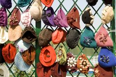 Many female headdresses are placed in a show-window. stock photo
