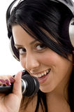 Female with headphone and microphone Stock Photography