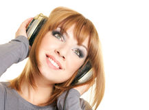 Female with headphones. Smiling beautiful woman with headphones isolated over a white background Stock Photography