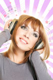 Female with headphones. Smiling beautiful woman with headphones Stock Photography