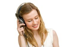 Female in headphones. On a white background Royalty Free Stock Photography