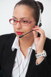 Female with headset Royalty Free Stock Photography