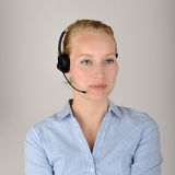 Female with headset. Young female caucasian blonde with headset smiling. Content for your contact page, very crisp photo Royalty Free Stock Photos