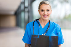 Female health care worker. Happy female health care worker with x ray Stock Photos