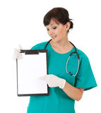 Female health care worker pointing to blank sign Royalty Free Stock Photo
