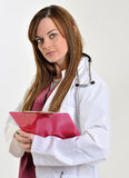 Female healthcare professional with clipboard - charting Stock Photography