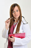Female healthcare professional with clipboard - charting Stock Photos
