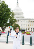 Female healthcare professional or doctor or nurse holding a sign which says health plan Stock Photography