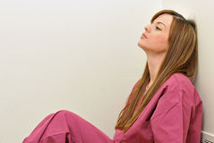 Female healthcare professional - exhausted or tired Royalty Free Stock Images