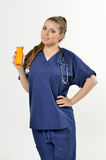 Female Healthcare Professional - pills Stock Photo
