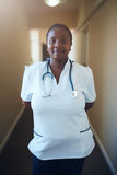 Female healthcare worker standing in hallway Stock Photography