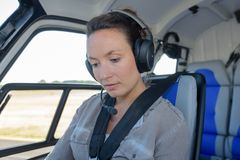 Female on helicopter tour Royalty Free Stock Photography