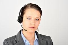 Female help desk worker. Looking at the camera, dressed in a suit. Real crisp photo with the focus on her eyes Stock Image