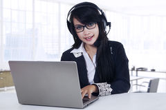 Female helpdesk working in office Royalty Free Stock Photo