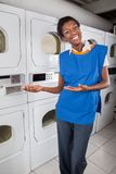 Female Helper Gesturing In Laundry Stock Image