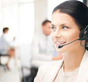 Female helpline operator in call center Royalty Free Stock Photo
