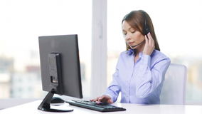Female helpline operator with computer at office stock video