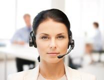 Female helpline operator with headphones Royalty Free Stock Images
