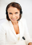 Female helpline operator with headphones Stock Photo