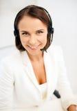 Female helpline operator with headphones Stock Photo