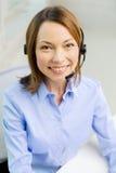 Female helpline operator with headphones Royalty Free Stock Photo