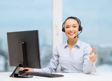 Female helpline operator showing thumbs up Stock Image