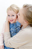 Female and her daughter sharing secrets. Royalty Free Stock Photos