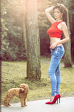 Female with her poodle dog in forest. Stock Photography