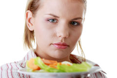 Female and her salad Royalty Free Stock Photography