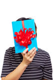 Female hide her face behind gift  box Stock Image